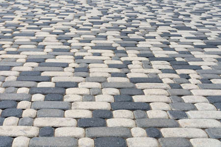 Pedestrian zone, paved with artificial stone, Pavement in perspective.