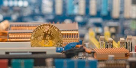 Modern blockchain technology, bitcoin coin on the computer motherboard Foto de archivo
