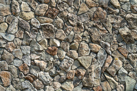 Wall of natural stone without the use of cement. Foto de archivo