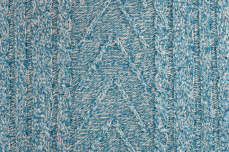Blue and white handmade yarn of wool, the texture of warm winter clothes. Foto de archivo
