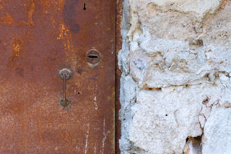 Very old iron door covered with rust