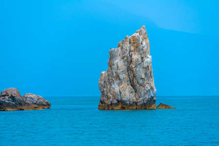 Lonely rock at Cape Ai-Todor in the black sea, near Yalta 스톡 콘텐츠 - 114970094
