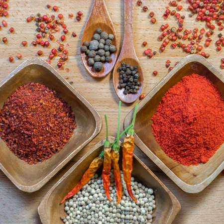 Spice mixing - red, black, white and paprika pepper. Foto de archivo