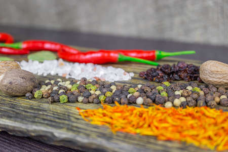 Oriental spices on the cutting Board, bright and spicy pepper, saffron and nutmeg
