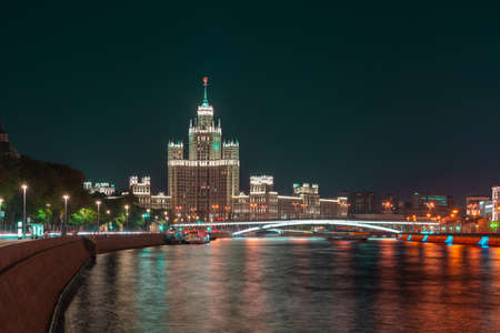 View cityscape Moscow at night. Historical building, high-rise on Kotelnicheskaya embankment and Moskva-river.