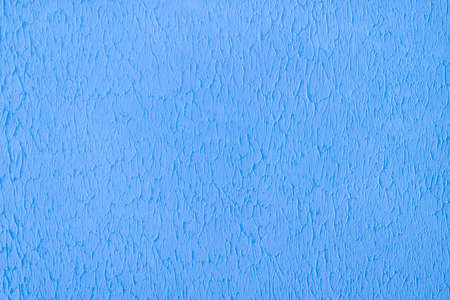 Plastered concrete wall, painted in bright blue, decorative surface texture 写真素材