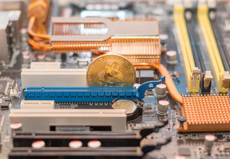 Bitcoin cryptocurrency on the computer motherboard. BTC cryptomoney