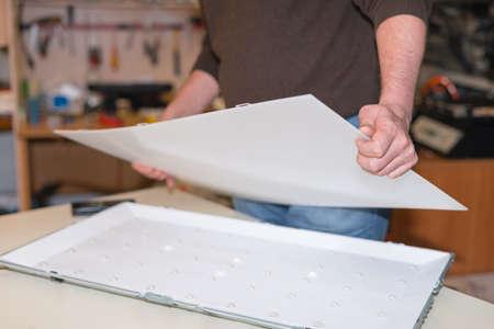 Disassembling the screen for repair of LED backlight on LCD TV Foto de archivo