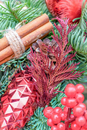 New Year and Christmas decoration with red cone and ball. Vertical photo