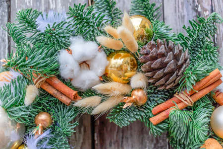 Christmas and New Year composition with cinnamon sticks, cone and golden ball. Foto de archivo