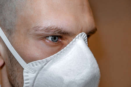 Man in a respirator. Paramedic in a medical mask. Viral pandemic and protection against coronavirus