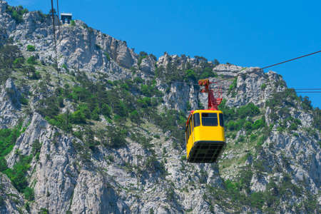Cablecar road on Ai-Petri mountains. Yellow cabin of ropeway