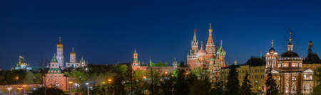 The panorama of center of Moscow city in bright night lights. Moscow Kremlin and Saint Basils Cathedral.
