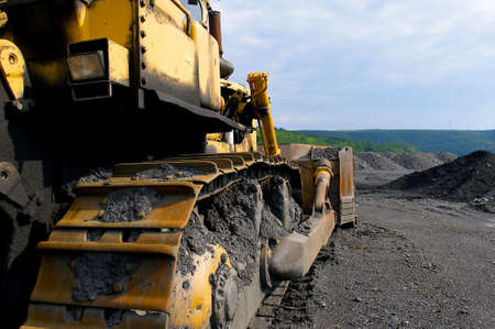 Industrial image of onstruction equipment.  Bull-dozer shown at a coal mine.