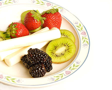 Healthy plate of fruit and cheese. Stock Photo