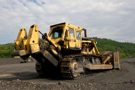Industrial image of construction equipment.  Bull-dozer shown at a coal mine.