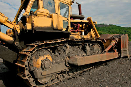 Industrial image of construction equipment. Bulldozer shown at a coal mine.  Stock Photo