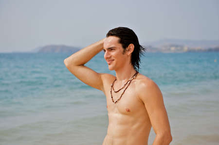 Muscular young man on the beach.