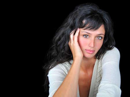 Beautiful brunette fashion model on black background. Stock Photo