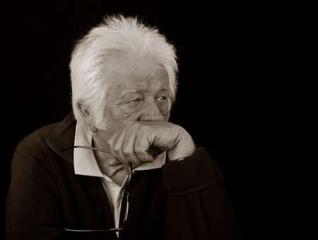 aging: Black and White Portrait of an elderly man with a serious expression.