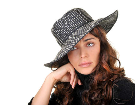 Gorgeous fashion model wearing a hat isolated on white background. Stock Photo