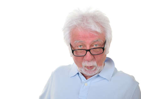 Elderly man with surprised expression on white background.