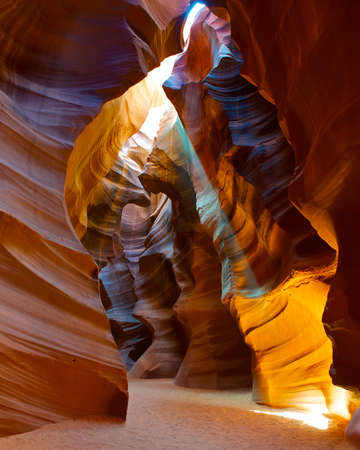 Colorful image of a sun light beam shining through the Upper Antelope slot Canyon. photo