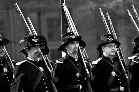 JAMESTOWN, VIRGINIAUSA - MARCH 18, 2012:  Black and white image of Civil War reinactors marching in formation during the Military through the Ages event on March 18, 2012 at the Jamestown Settlement.  Editorial
