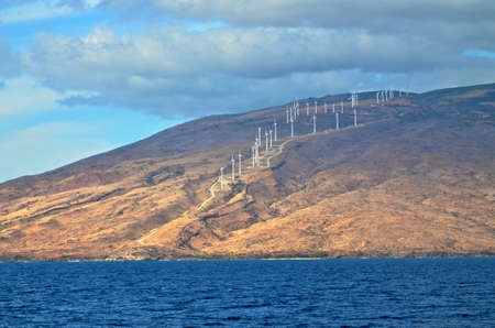 Wind power on the volcanic hills of Maui in Hawaii Stock Photo