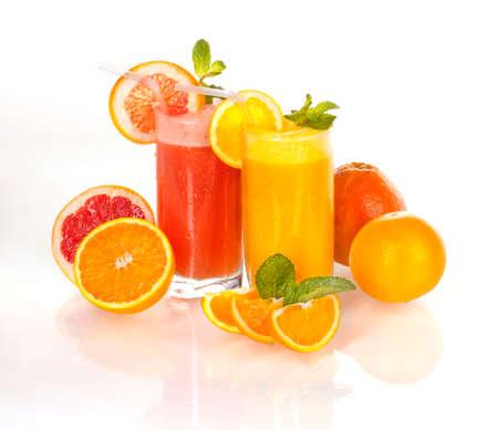 homogeneous: Fresh orange and grapefruit juice on a homogeneous background
