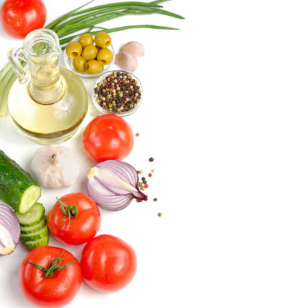 Set of fresh vegetables with olive oil on the white background photo