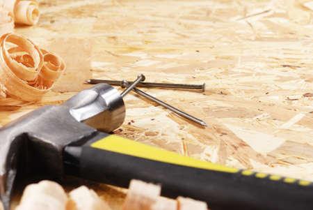 osb: Hammer, nails, and shavings on the hardboard