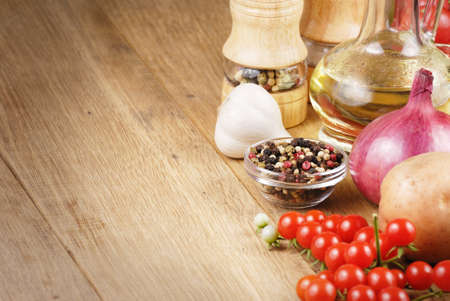 Raw vegetables ,olive oil and spices Stock Photo - 10661222