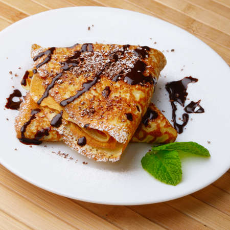 French style crepes with chocolate sauce and sugar powder Stock Photo