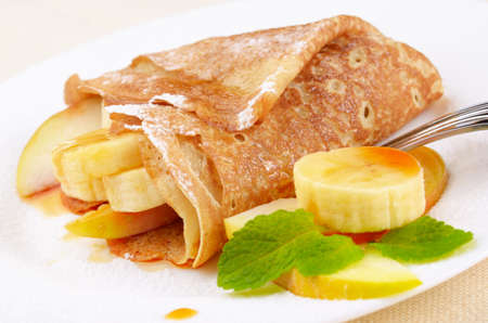 French style crepes with apples, banana, maple syrup and sugar powder