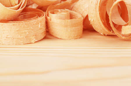 Wooden chips on the natural pine plank photo