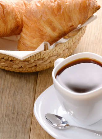 Morning black coffee with croissants on the wooden table photo