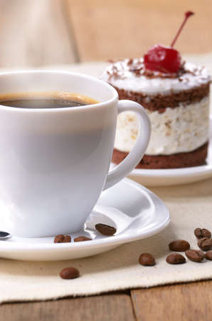 Cream cherry cake and coffee cup