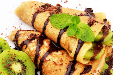 French style crepes with kiwi and chocolate syrup Stock Photo