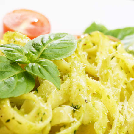Pasta tagliatelle with pesto sauce basil and grated parmesan photo