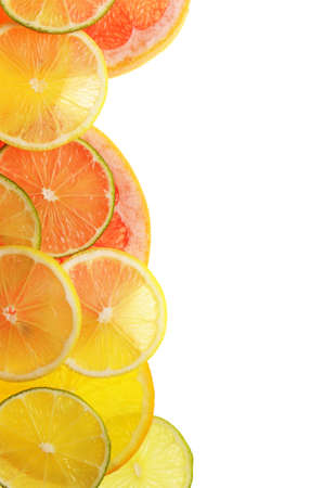 lime lemon grapefruit and orange slices over white photo