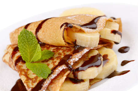 French style crepes with banana over white photo