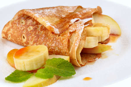 maple syrup: French style crepes with banana over white
