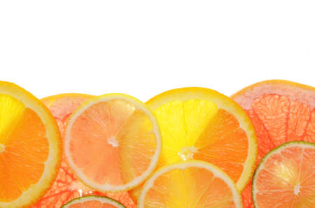 lime lemon grapefruit and orange slices over white