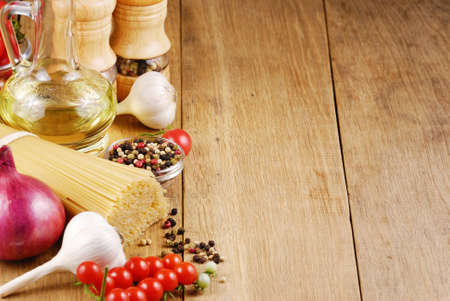 Raw vegetables olive oil pasta and spices Stock Photo