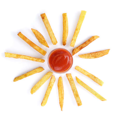 fries: Potato chips and ketchup over white background Stock Photo