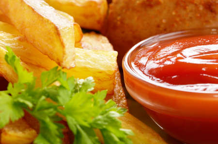French fries with ketchup closeup view photo