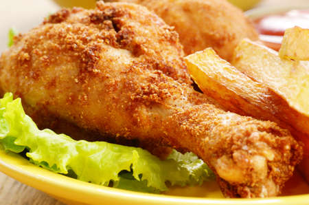 chicken leg: Fried drumsticks with french fries on the table Stock Photo