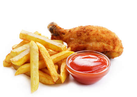 Fried drumsticks with ketchup and french fries over white background