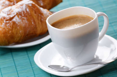 Morning cappuccino coffee with croissants on the wooden table photo
